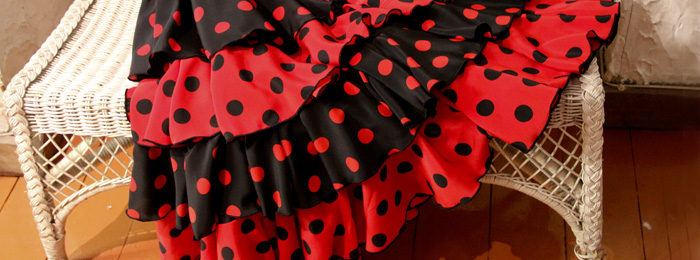 Flamenco dress on a chair - flamenco dresses and skirts category banner